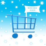 Winter sale shopping cart. On snow flakes Royalty Free Stock Photography