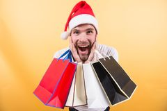 Winter sale, shopping concept. Macho shopper with surprised face hold paperbags. Christmas, new year surprise, presents. Happy holidays celebration. Man in Stock Photos