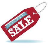 Winter sale with snow and ribbon tag Royalty Free Stock Photography