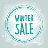 Winter sale with snowflakes banner. Winter sale with snowflakes over blue drawn background, business seasonal shopping concept banner vector illustration