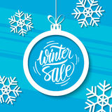 Winter Sale. Special offer banner with handwritten text design and christmas ball. Royalty Free Stock Photography