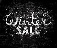 Winter sale text lettering. Seasonal shopping concept to design banners, price or label. Stylized drawing chalk on blackboard. Isolated vector illustration Royalty Free Stock Photos