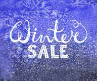 Winter sale text lettering on watercolor background. Seasonal shopping concept to design banners, price or label. Stock Photo