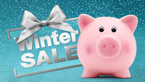 Winter sale text with piggy bank, silver ribbon bow, Isolated Stock Photography