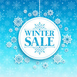 Winter Sale Text in White Space with Snow Flakes Stock Images