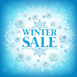 Winter Sale Text in White Space with Snow Flakes. Hanging in Blue Pattern Background. Vector Illustration Royalty Free Stock Images