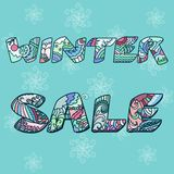 'Winter sale' words with hand drawn elements Stock Images