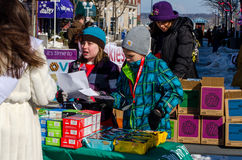 Winter sales of girl scout cookies Stock Photos