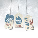 Winter sales labels on a snowy background Stock Images