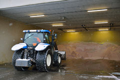 Winter salt and tractor on winter depo. Tractor working with winter salt for icy roads Royalty Free Stock Photo