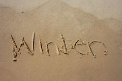 Winter in the sand. Winter written in the sand royalty free stock photo