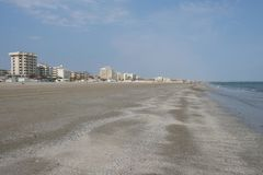 Winter sandy beach in Rimini, Italy. Empty during the off season. Panorama of the sky and the beach stock photos