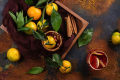 Winter sangria in wooden box with tangerines Royalty Free Stock Image