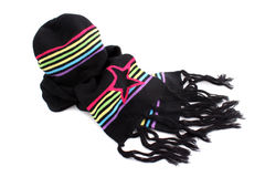 Winter scarf and hat. Black and rainbow colored winter wool  knitted scarf and  hat to keep warm in winter Stock Photography