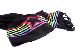 Winter scarf and hat. Black and rainbow colored winter wool  knitted scarf and  hat to keep warm in winter Stock Images