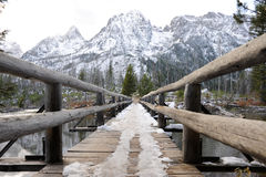 Winter Scene. Footbridge to mountains in winter Royalty Free Stock Photo