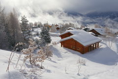 Winter scene. A chalet in winter in the Swiss Alps royalty free stock image