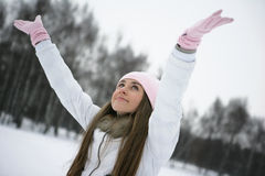 Winter scene. Girl in winter in the park playing snowballs Royalty Free Stock Images