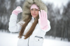 Winter scene. Girl in winter in the park playing snowballs Stock Photos