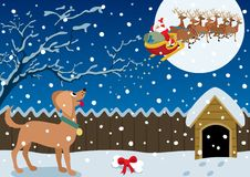 Winter Scene. Santa just brought a Christmas gift to the good doggy Stock Photography