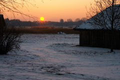 Winter scene. Winter, snow, sunset, evening, village Royalty Free Stock Images