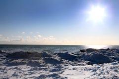 Winter scene. Beautiful winter nature scene, snow and ice around ocean, sun Stock Image