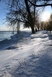 Winter scene. Beautiful winter nature scene, snow and ice around ocean, sun Royalty Free Stock Photos