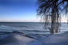 Winter scene. Beautiful winter nature scene, snow and ice around ocean, sun Stock Photo