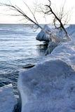 Winter scene. Beautiful winter nature scene, snow and ice around ocean, sun Royalty Free Stock Photo