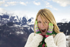 Winter scene. Astonished woman with hands on cheeks stock photo