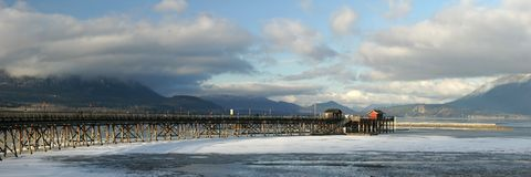 Winter scene. Wharf on frozen lake in winter - Salmon Arm, Canada stock images