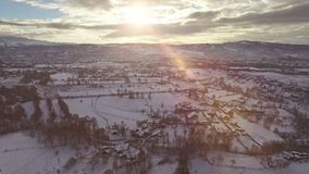 Winter scene aerial view, countryside village at sunset stock video footage