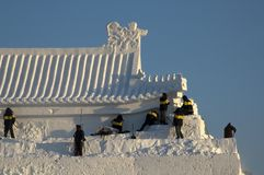 Creating a snow sculpture in Sun Park royalty free stock image