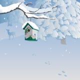 Winter scene with birdhouse, forest, deer. Stock Photo