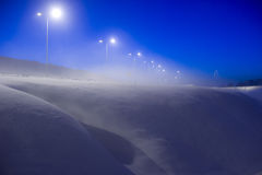 Winter scene with. Blue winter scene with road lights at late evening Royalty Free Stock Photo