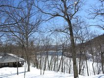Winter Scene Cabin Overlooking Hessian Lake Bear Mountain New York. Forest snowy scene blue Stock Images