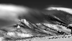 Winter scene in the Carpathian mountains , remote and harsh environment. With blizzard and wind and clouds stock photo