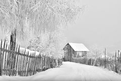 Winter scene in the Carpathian mountains , remote and harsh environment. With blizzard and wind and lenticular clouds ,old houses and traditional houses royalty free stock photography