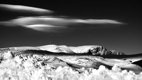 Winter scene in the Carpathian mountains , remote and harsh environment. With blizzard and wind and lenticular clouds royalty free stock photography