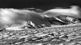 Winter scene in the Carpathian mountains , remote and harsh environment. With blizzard and wind and lenticular clouds royalty free stock image