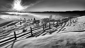 Winter scene in the Carpathian mountains , remote and harsh environment. With blizzard and wind and lenticular clouds ,old houses and traditional houses stock images
