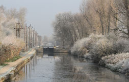 Winter scene at Cheshunt Lock on the River Lee Navigation . A Winter landscape scene of a part frozen canal and frosty trees and plants, at Cheshunt Lock on the stock photography