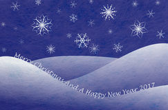 Winter scene, christmas card. Winter scene with snowy mountains and snowflakes and the words Merry Christmas and a happy new year, christmas card Stock Images