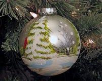 `Winter Scene` Christmas Ornament. A `Winter Scene` Christmas Ornament adorns a Christmas Tree Royalty Free Stock Photography