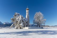 Winter scene - church in the German Alps stock images