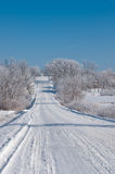 Winter scene on a country road in rural Iowa. Frosty winter scene with snow on a country road in rural Iowa Royalty Free Stock Image