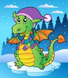 Winter scene with cute dragon Stock Photo