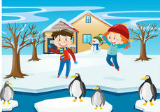 Winter scene with kids and penguin Royalty Free Stock Images