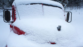 Winter scene of an old pickup truck in the snow Stock Photos