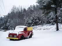 Winter scene of an old pickup truck in the snow Stock Photo